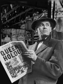 Promotional photo of Henry Fonda at a subway station, reading a newspaper with a headline describing a crime he would soon be accused of.