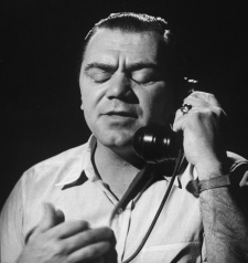 Ernest Borgnine, talking on phone with his eyes shut. (Photo by Allan Grant/The LIFE Picture Collection via Getty Images)